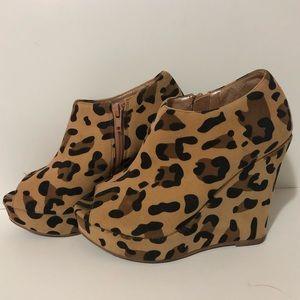 Cute cheetah print, peep toe, bootie style wedges.
